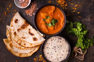 Picture of a curry with rice and naan bread